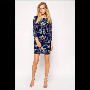 Blue needle and thread dress